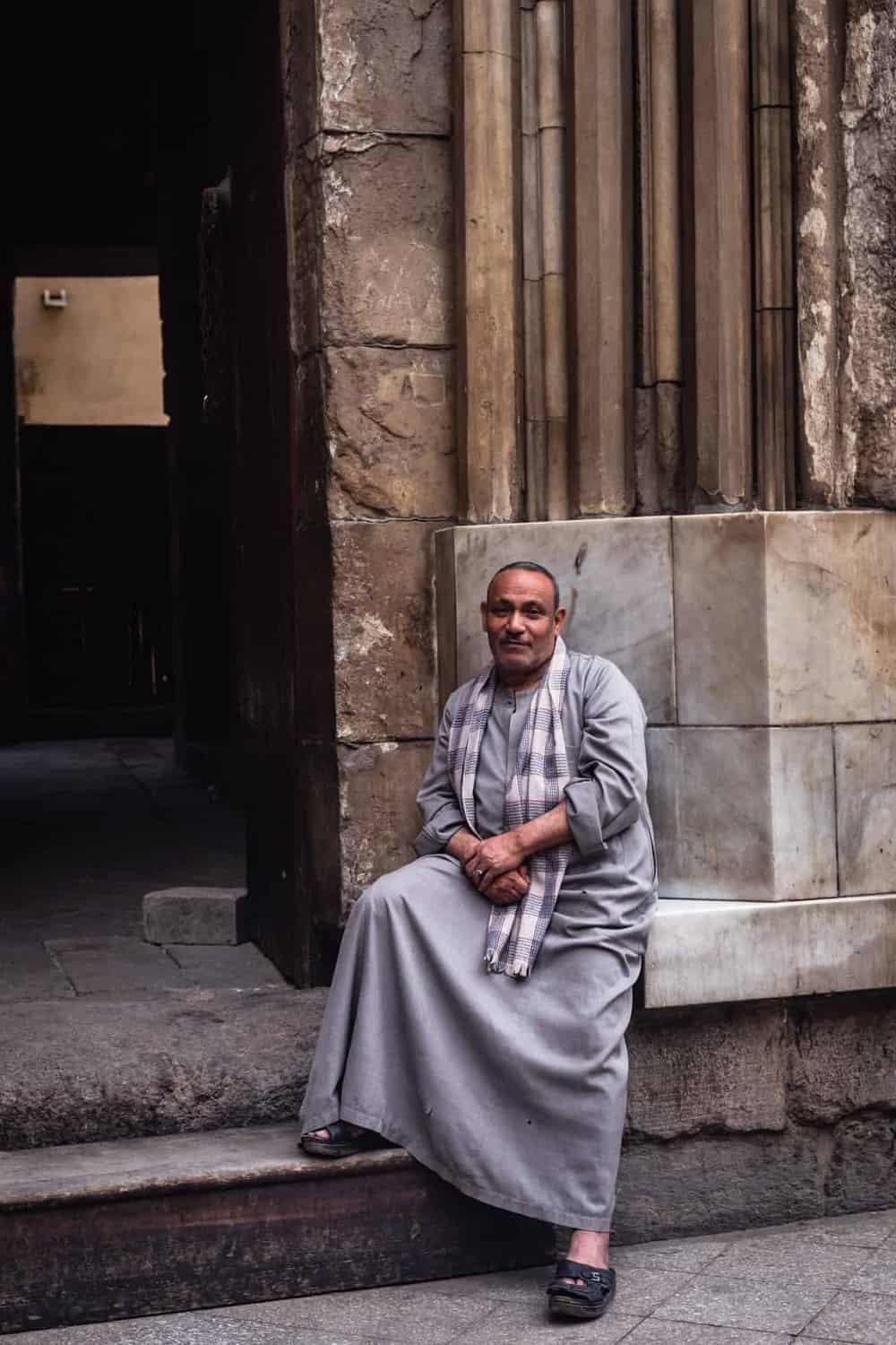 portrait shot of a man wearing traditional Egyptian clothing posing in Old Cairo.