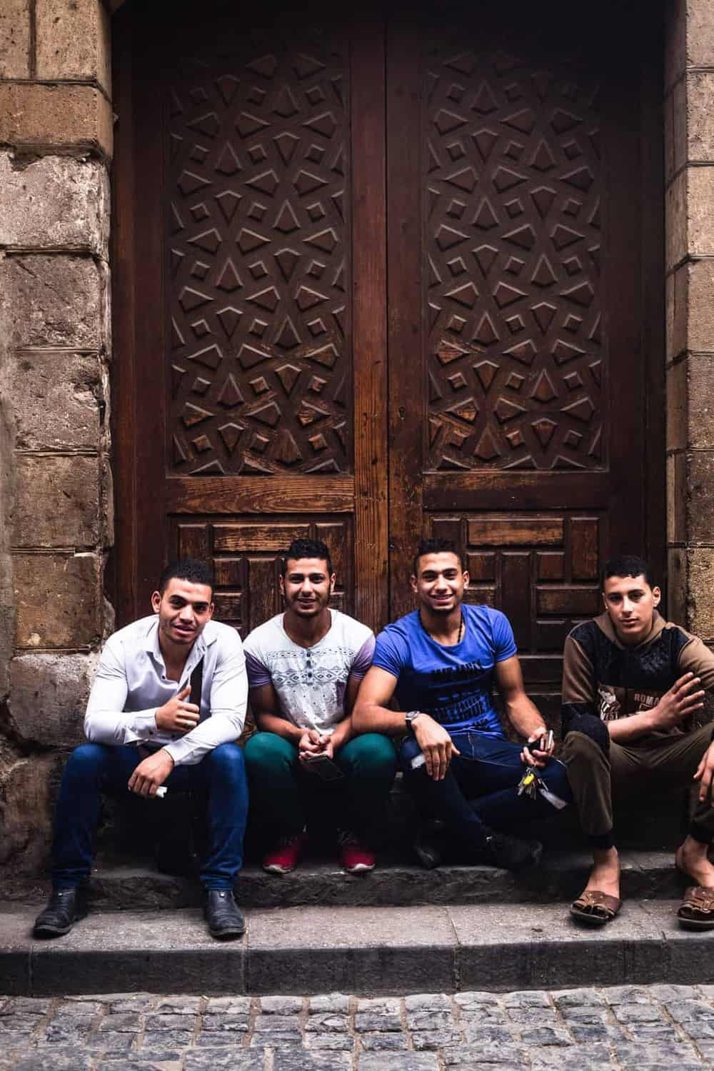 portrait shot of 4 friends looking happy and posing in Old Cairo.