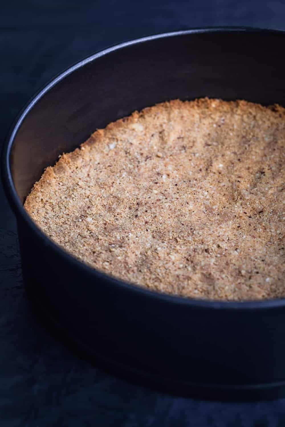 Graham Cracker crust in springform pan, ost oven.