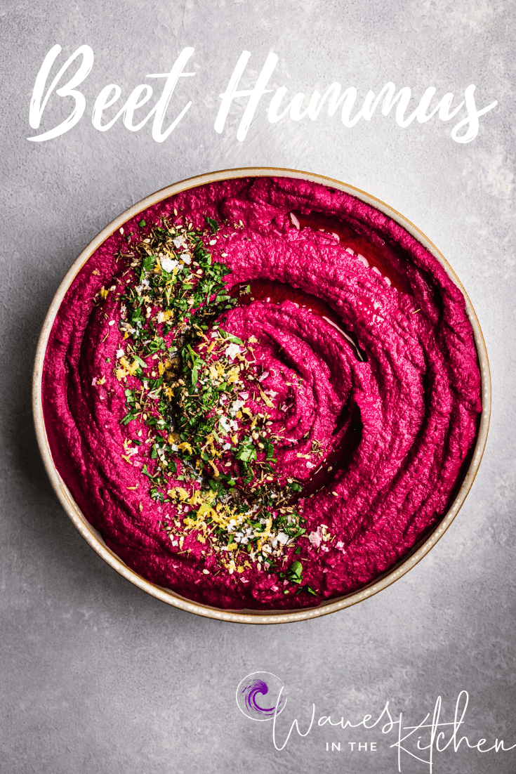Beet Hummus with Parsley, Lemon Zest, Za'atar & Flaky Sea Salt, in white bowl.