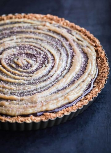 Finished tart with tahini swirl, side angle shot.