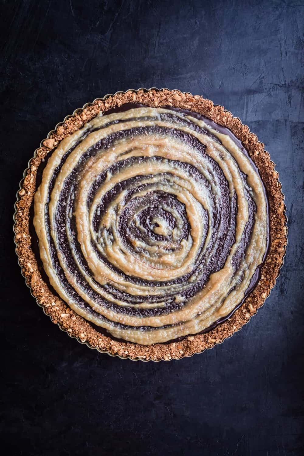 Finished tart with tahini swirl, overhead shot.