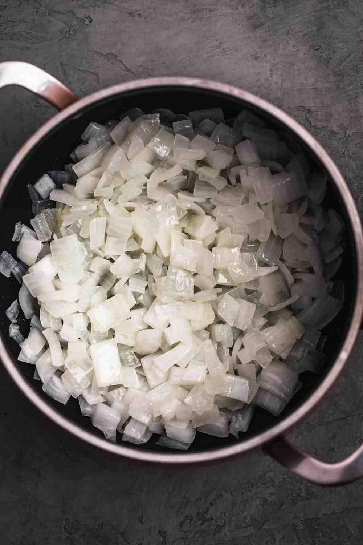 Sautéed onions in a pot.
