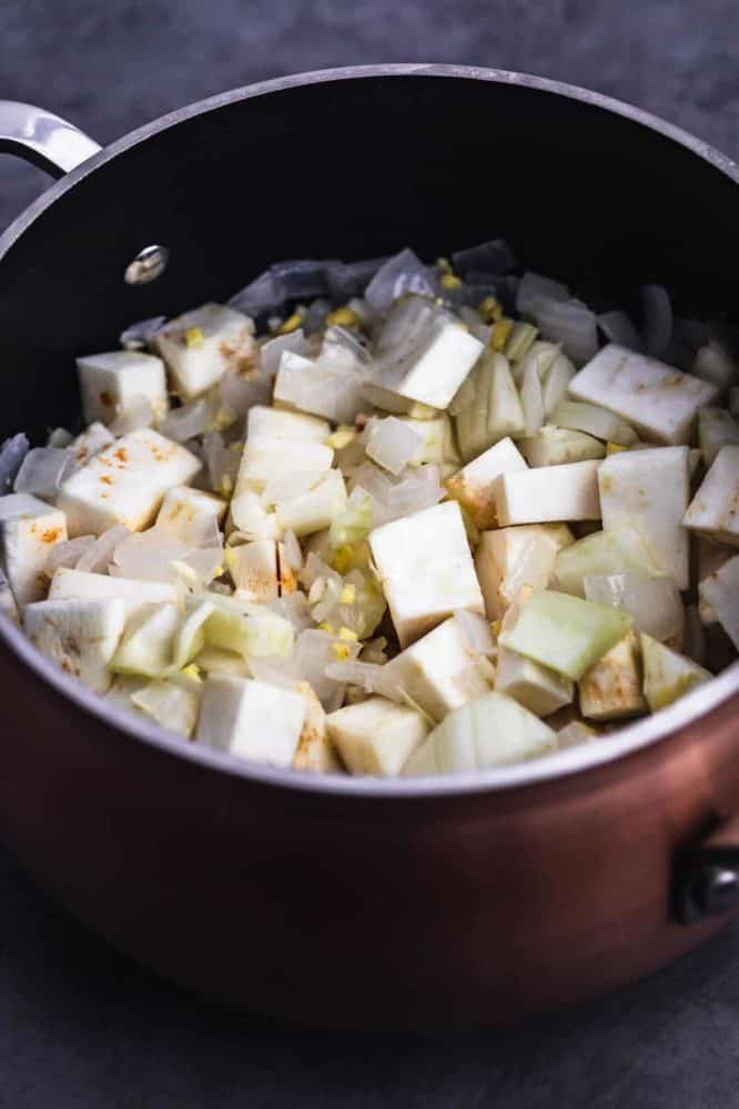 In process shot with celery root, fennel, ginger and garlic added to put with sautéed onions.