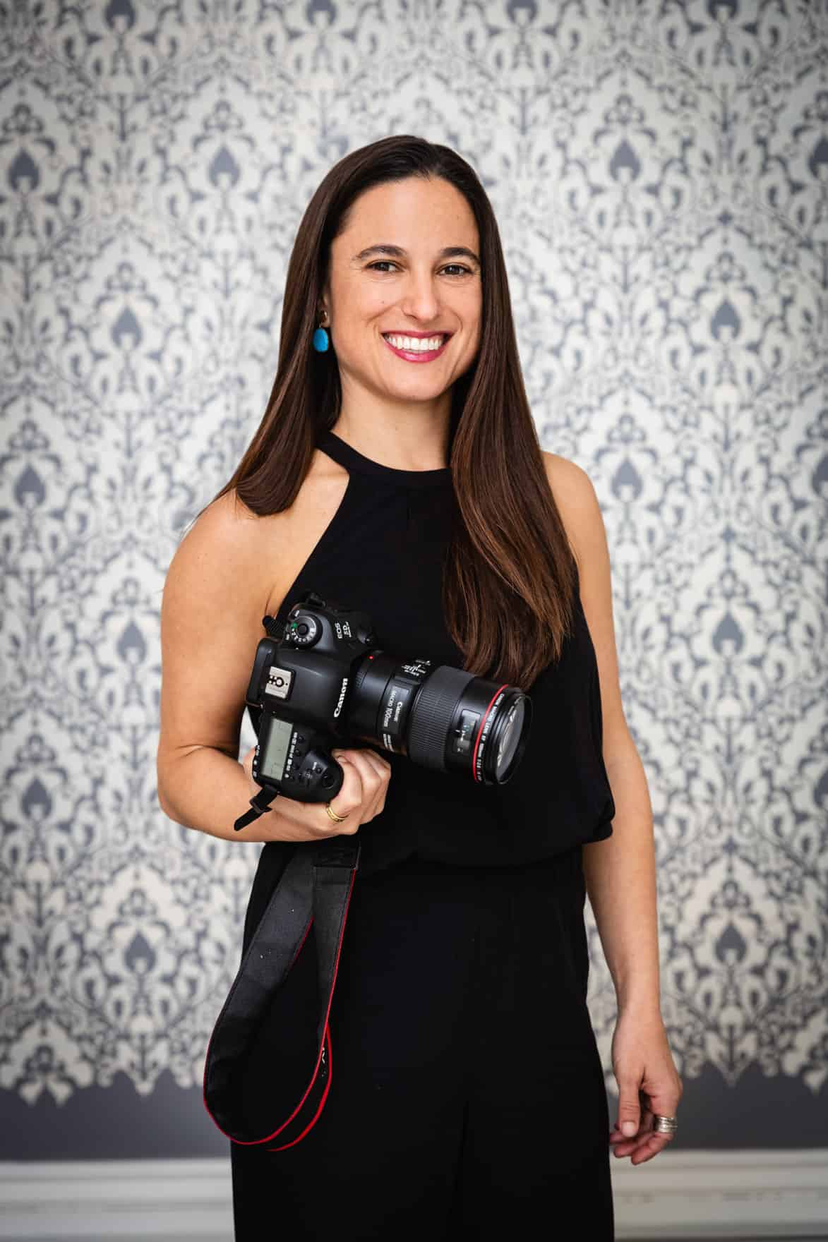 Chef Daniela Gerson holding her camera.