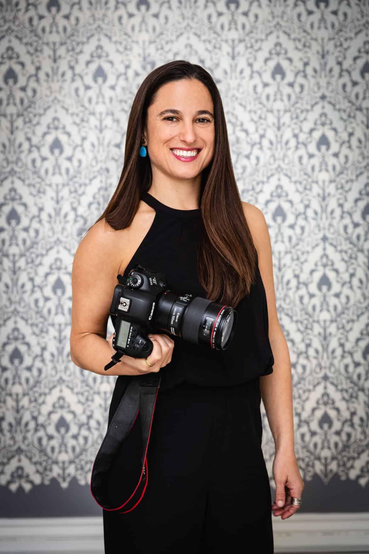 Chef Daniela Gerson holding her camera.
