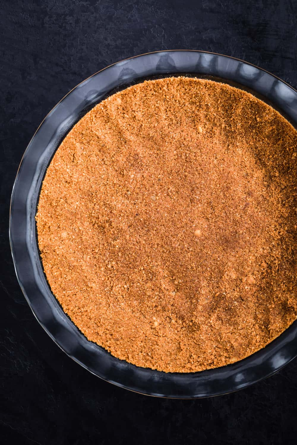 Ginger snap crust patted into the pie plate and ready for the oven.