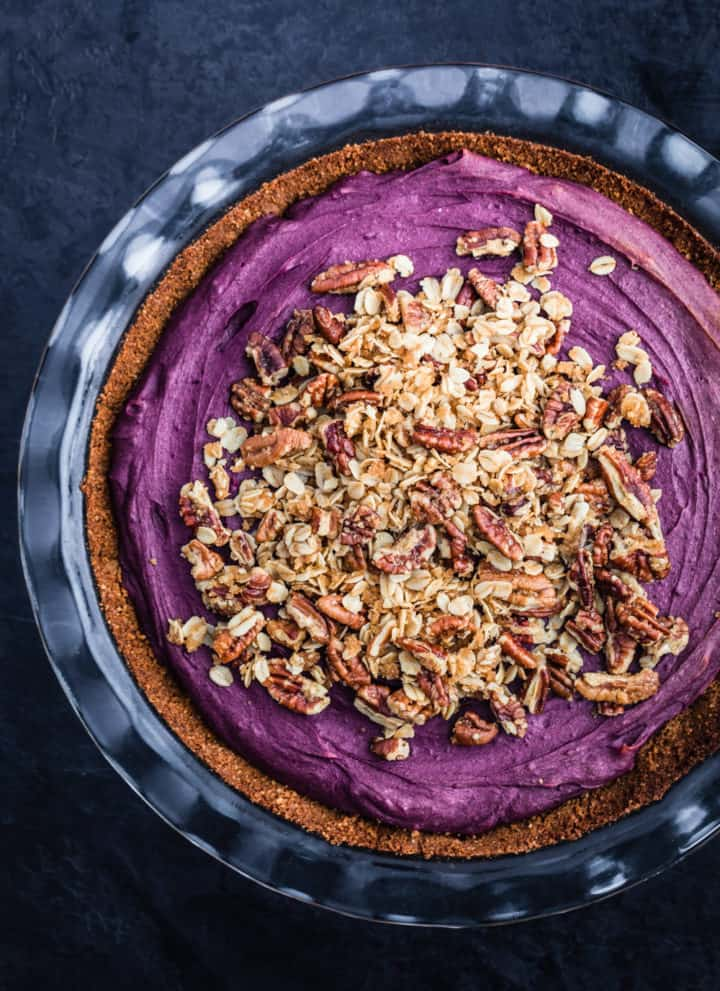 Purple sweet potato pie has been topped with pecan streusel.