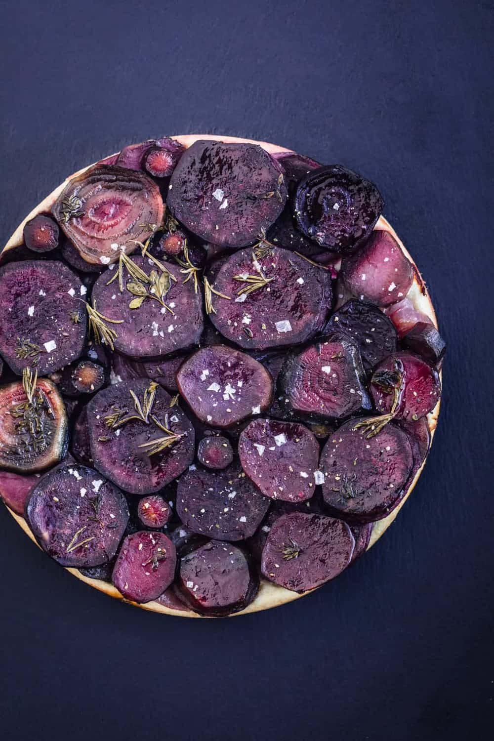 Mostly purple root vegetable tarte tatin all done with fresh herbs and flaky sea salt.