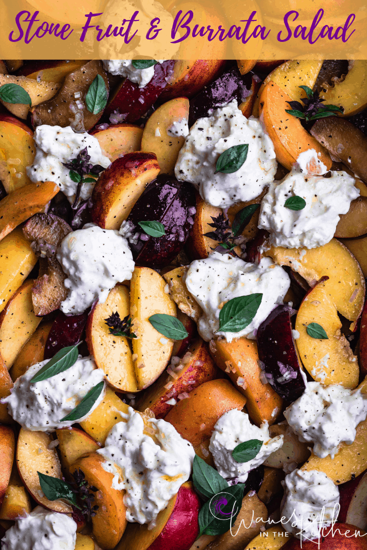 Stone Fruit & Burrata salad with basil and dressing all ready to be served.