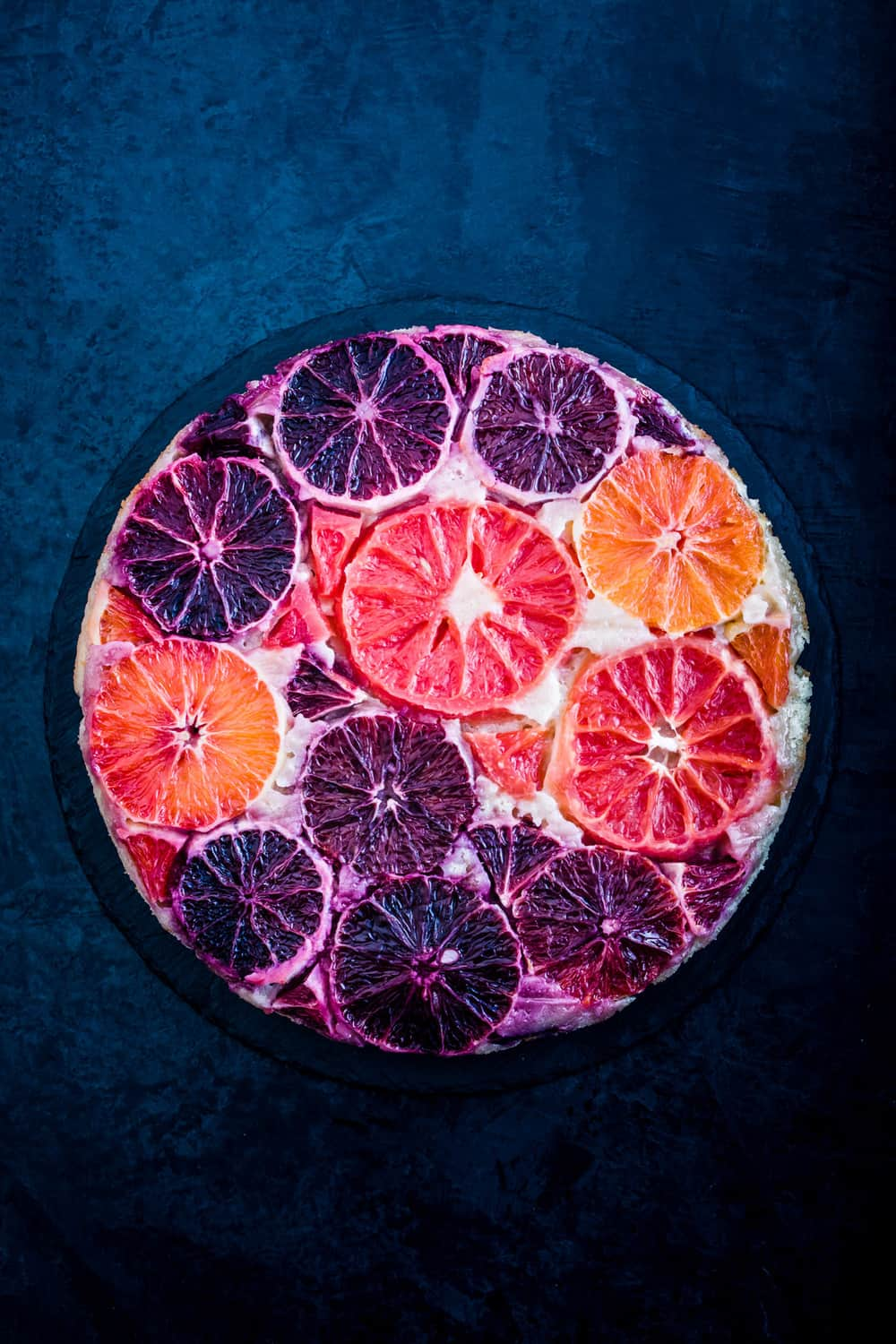 Winter Citrus Upside Down Cake all done, on a black background.