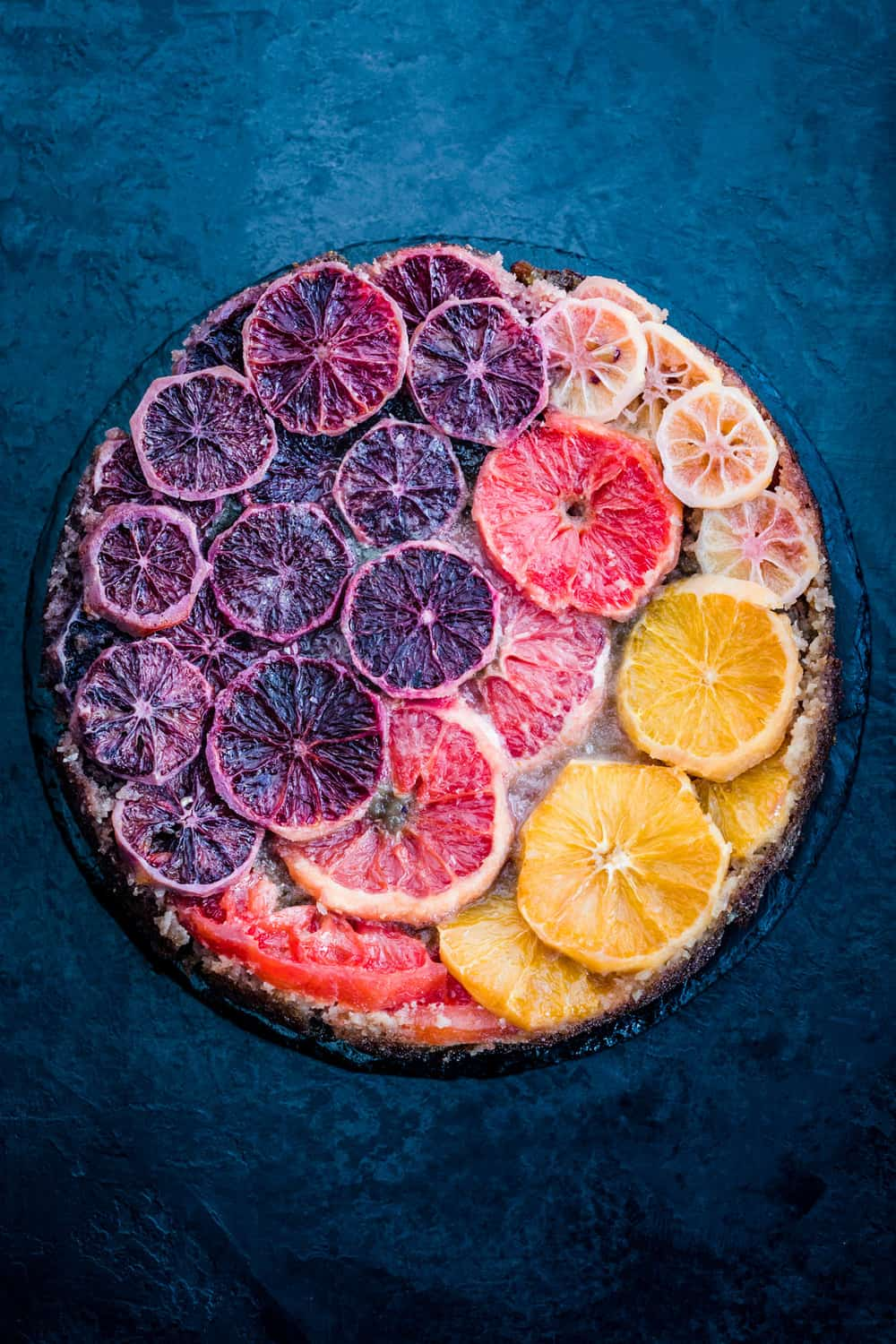 Winter Citrus Upside Down Cake all done, arranged in a rainbow across the cake.