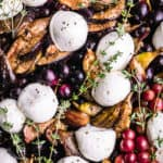 Grapes with Figs, Burrata & Fresh Herbs. Pre oven. Overhead and up close shot.