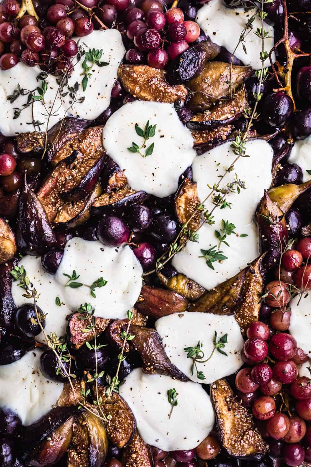 Post-oven Roasted Grapes with Figs, Burrata & Fresh Herbs. Post oven. Overhead shot.