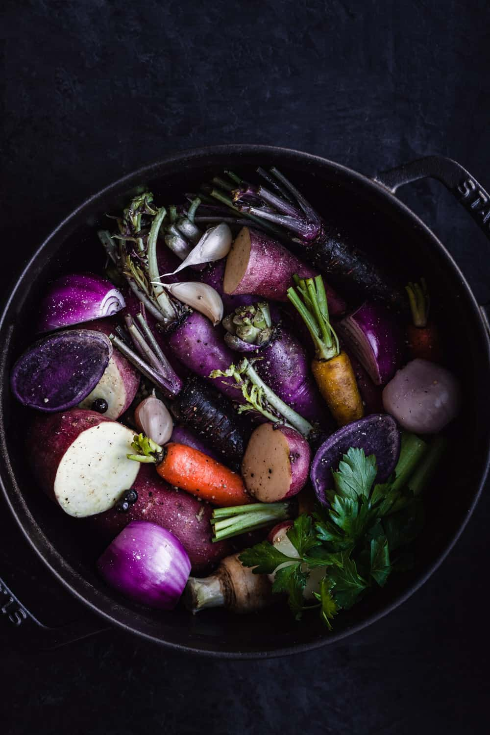 Magic Mineral Broth in the making. A pot filled with potatoes, carrots, yam, garlic, radishes, red onions and some spices.