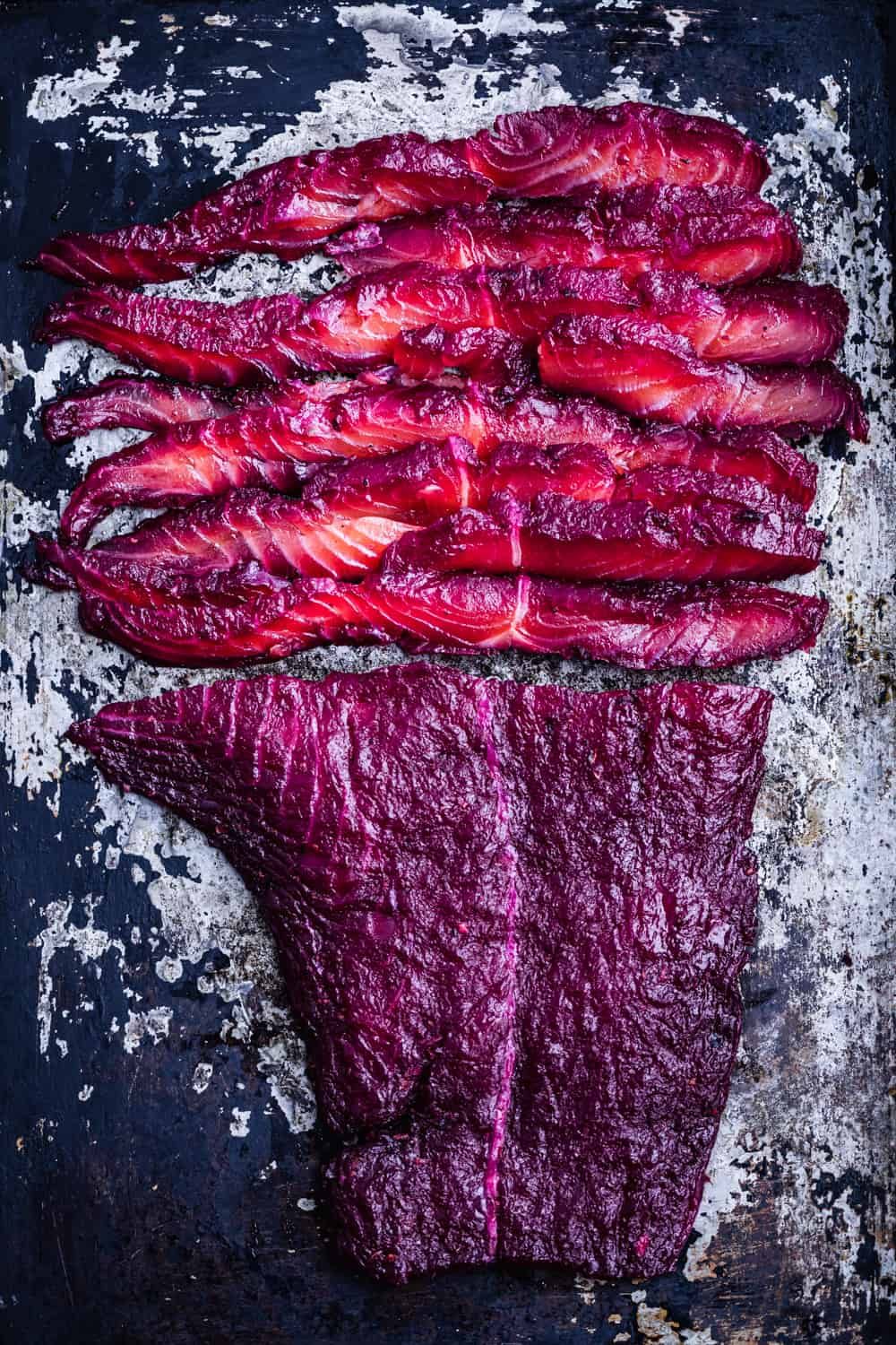 Thinly sliced beet cured salmon.