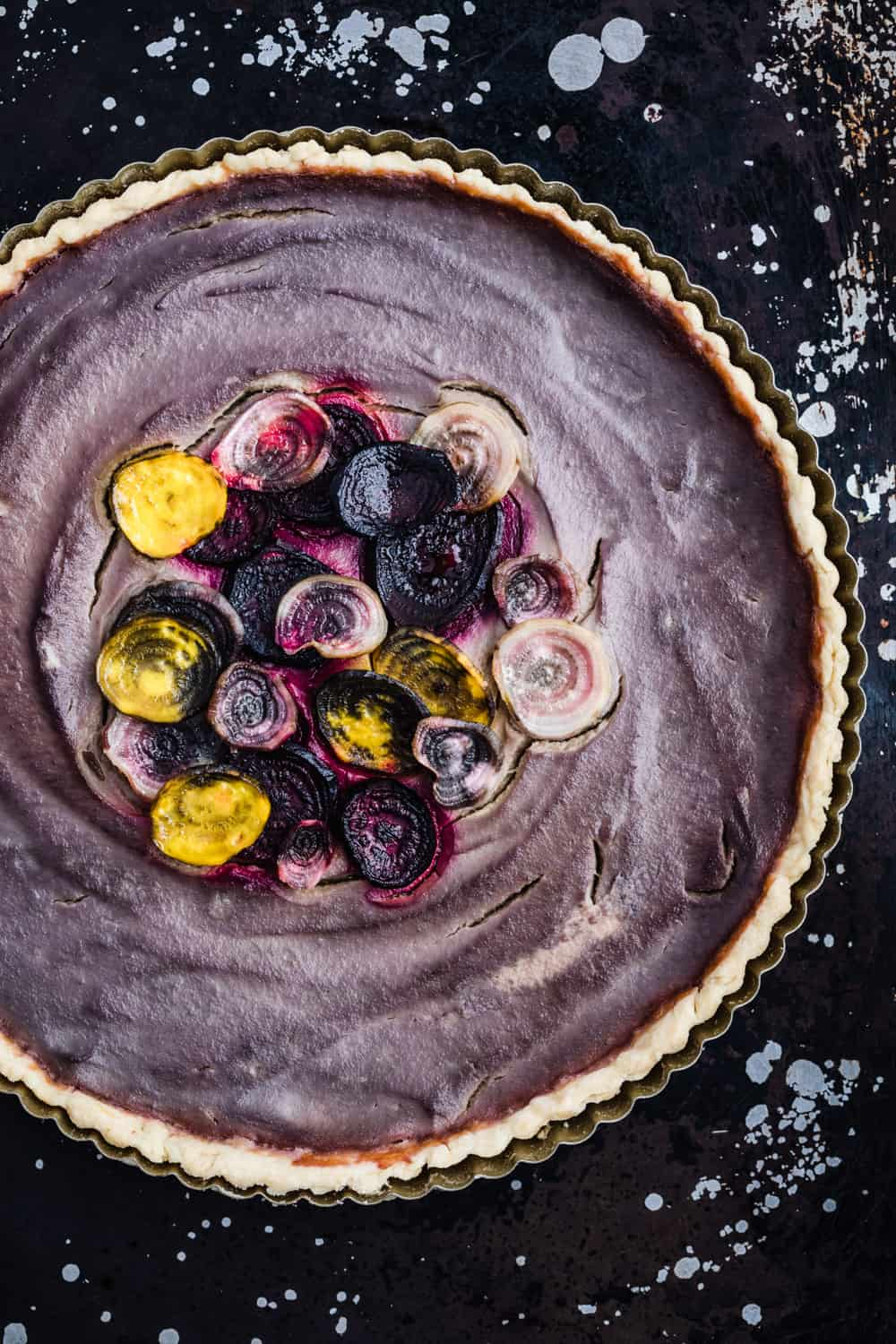 Purple cauliflower tart, topped with 3 color of beets, post-oven.