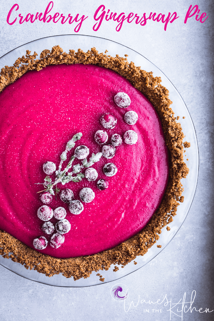 Cranberry Gingersnap Pie. Topped with sugared cranberries and sugared thyme. overhead shot, on a white background, left side cut off.