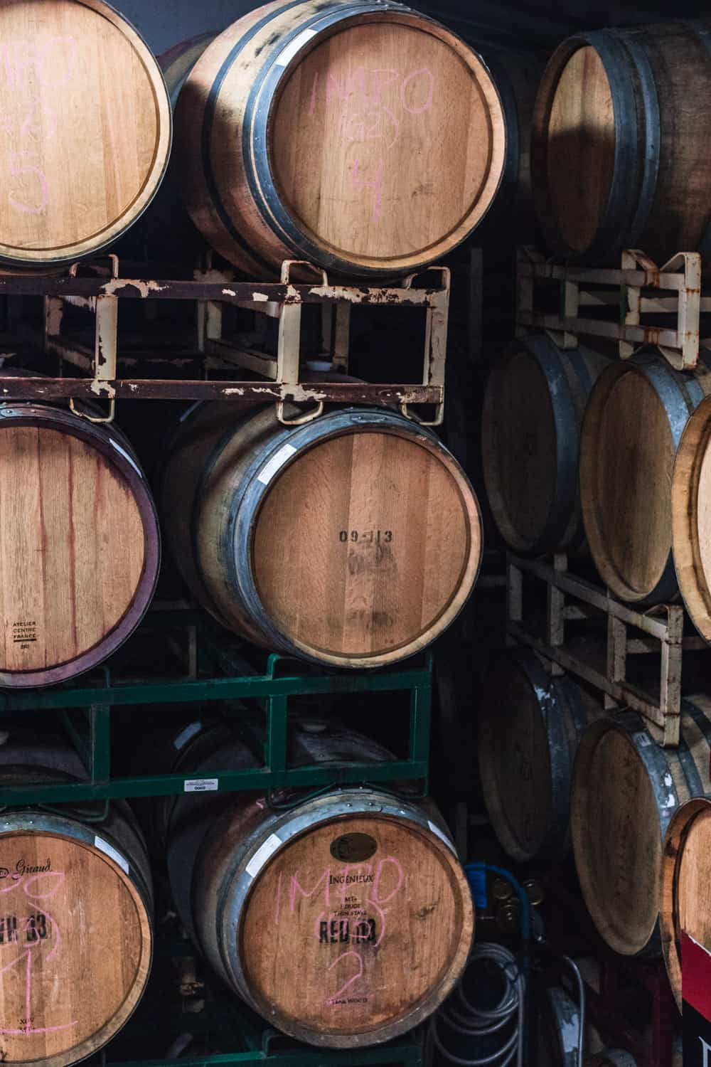 The wooden barrels aging the wine at Davero's biodynamic farm and winery.