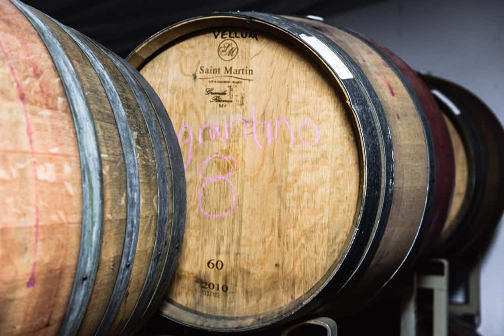 A close up of the oak barrels at Davero's biodynamic farm and winery.