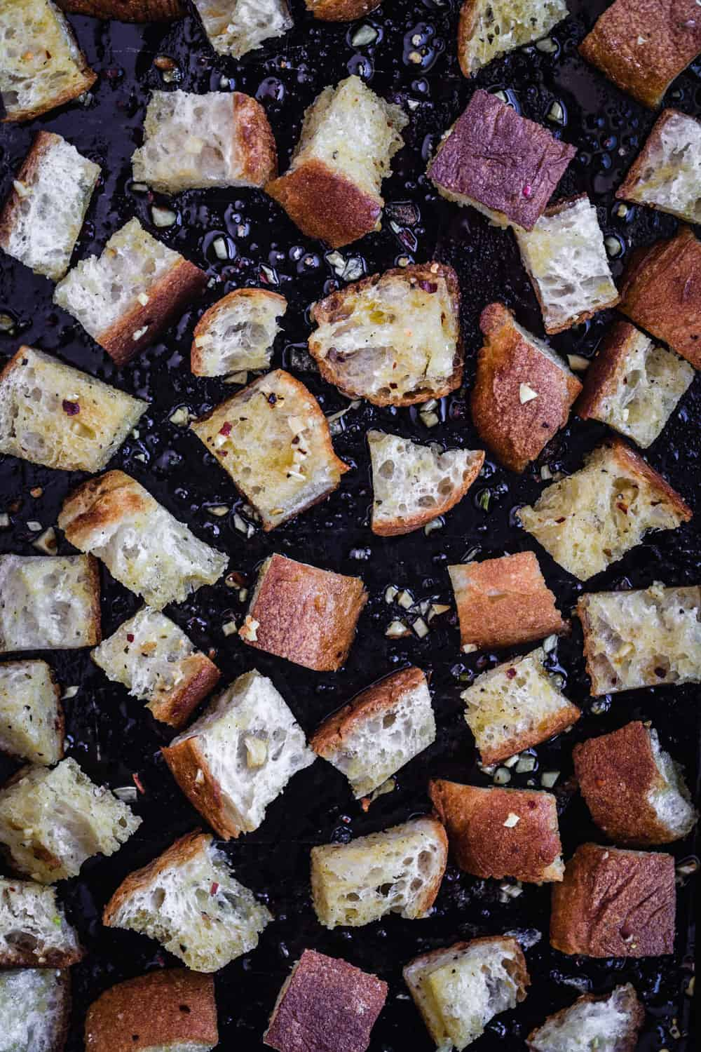 Croutons just out of oven, on baking sheet.