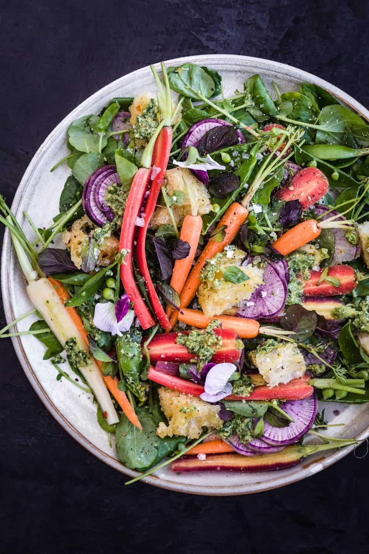 Overhead shot of the spring salad on white dinner plate.