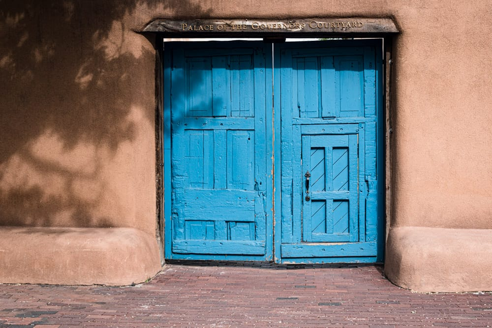 Turquoise wooden door at the Palace of the Governors Courtyard in Sata Fe.