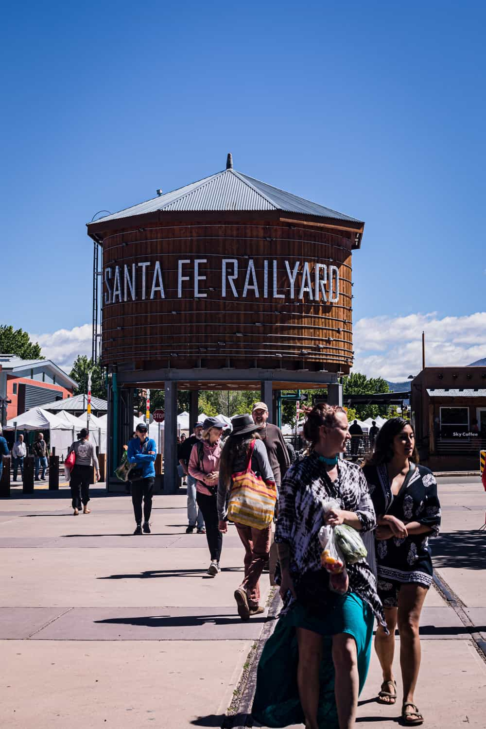 Santa Fe Railyard, filled with people at the Saturday Santa Fe Farmers Market.