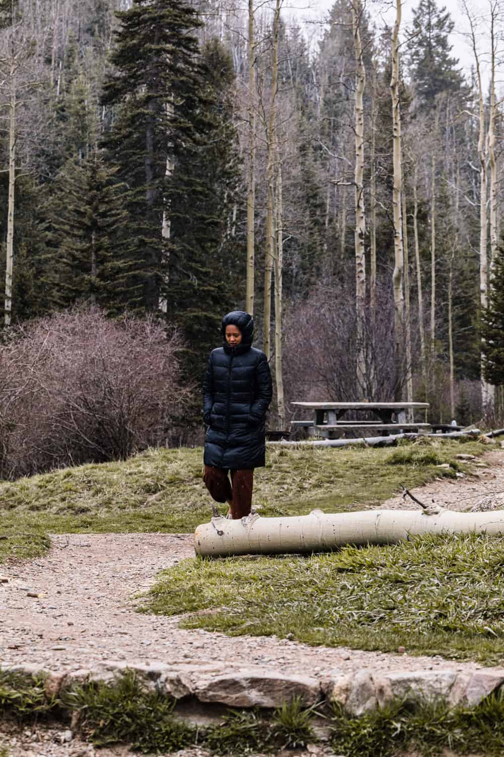 A women walking in the Sangre de Cristo Mountains just outside of Santa Fe.