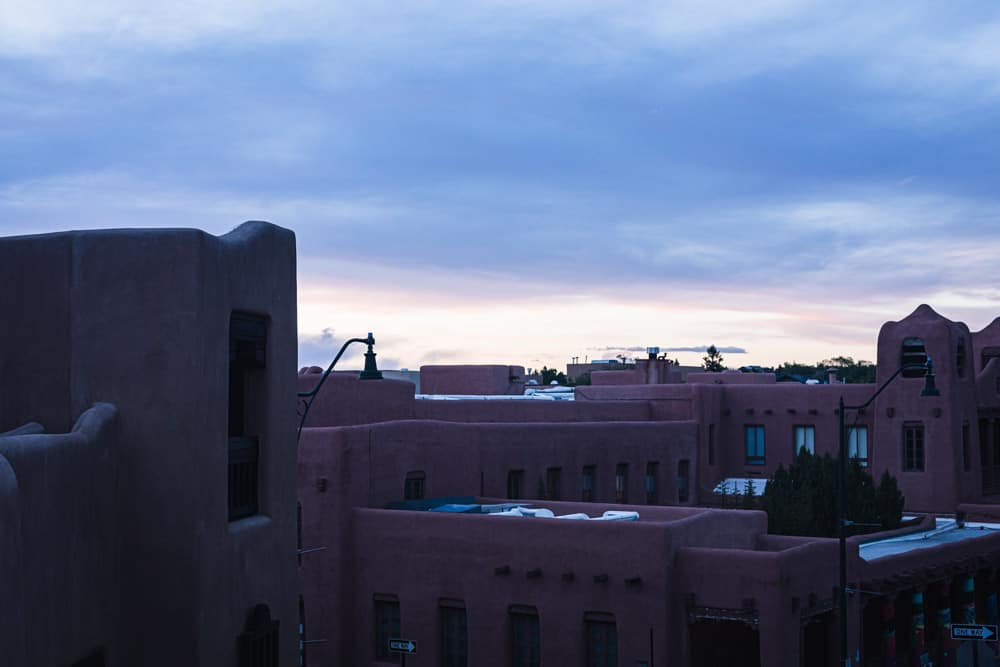 The view of the sun setting over Santa Fe from La Fonda's rooftop bar.