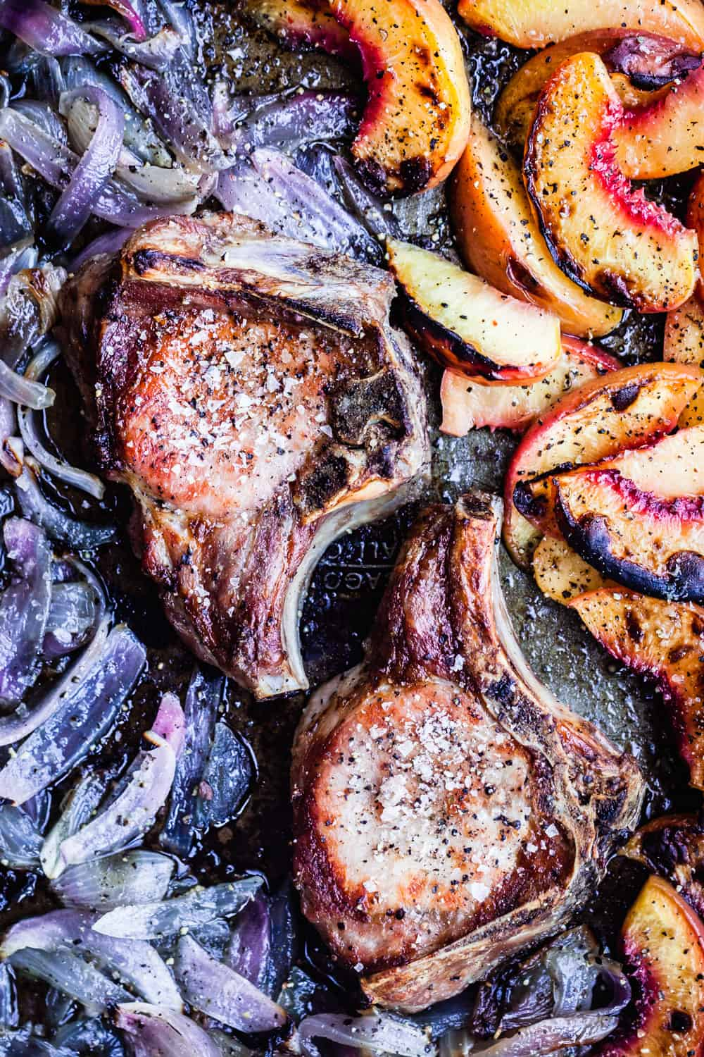 Pork Chops with Red Onions and Peaches in a sheet pan, post oven.