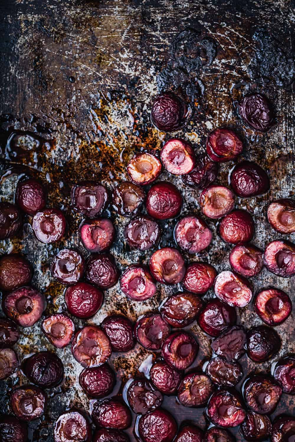 Roasted pitted cherries, on a cookie sheet, straight out of the oven.