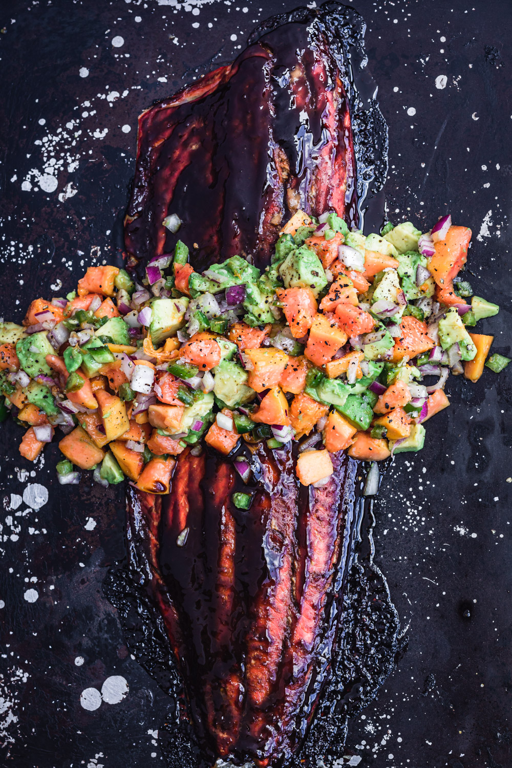 Salsa negra salmon with a papaya avocado salsa.