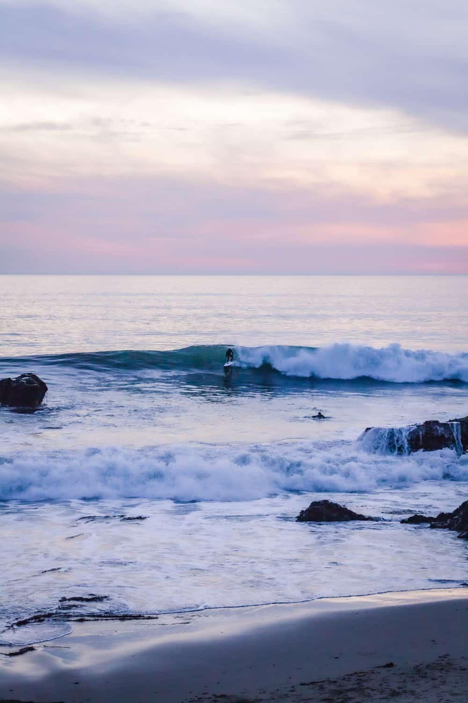 A surfer getting into a wave in Santa Cruz