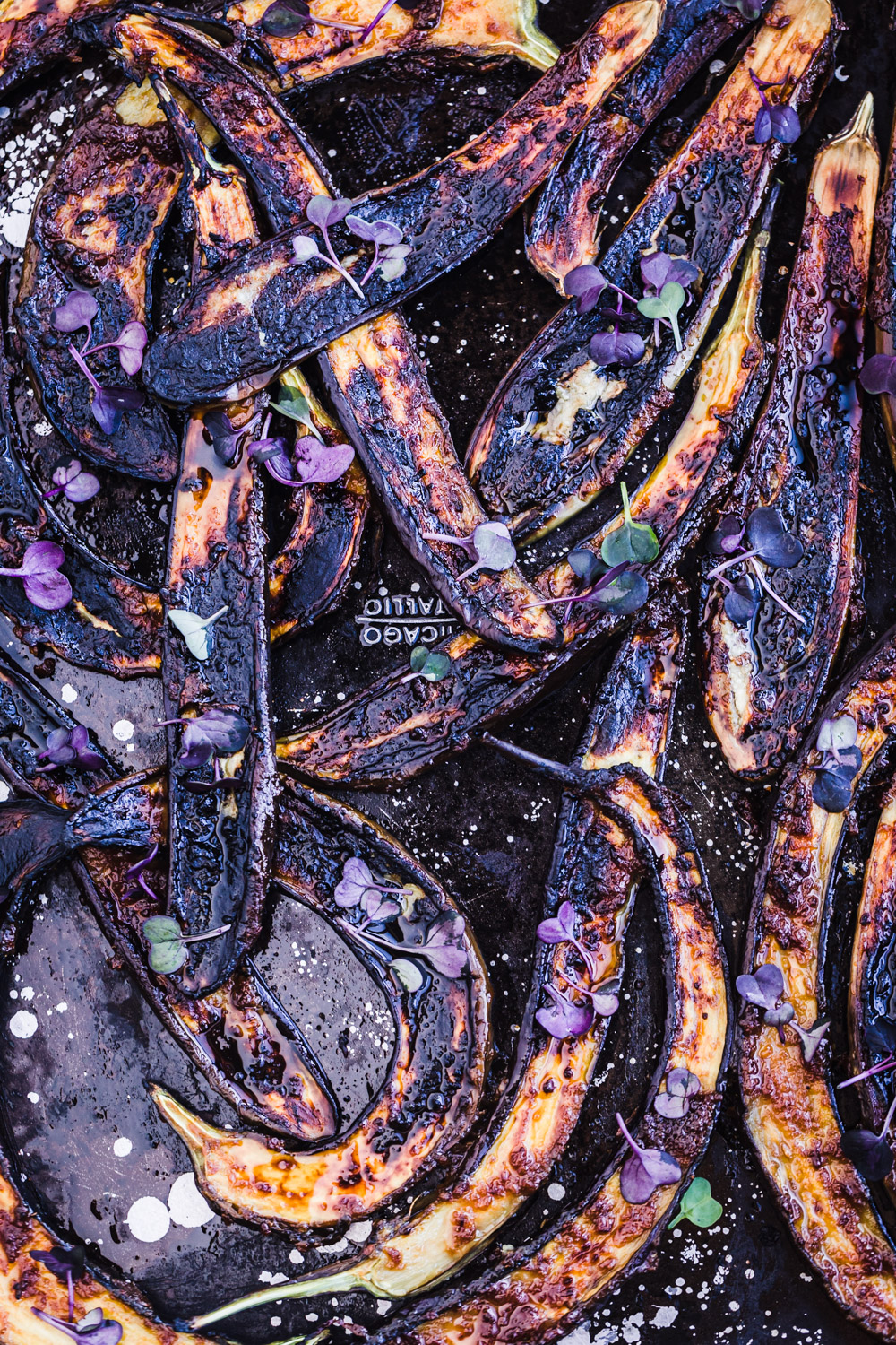 Up close and overhead shot of charred ginger-miso glazed eggplant.