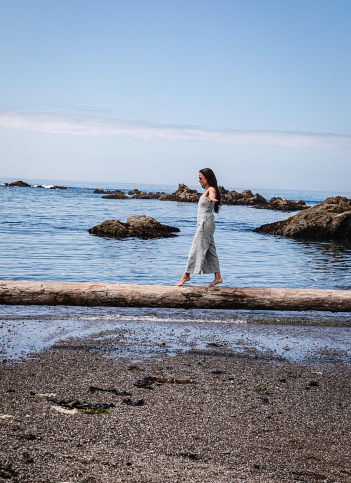 Daniela Gerson balancing on log at Glass Beach.