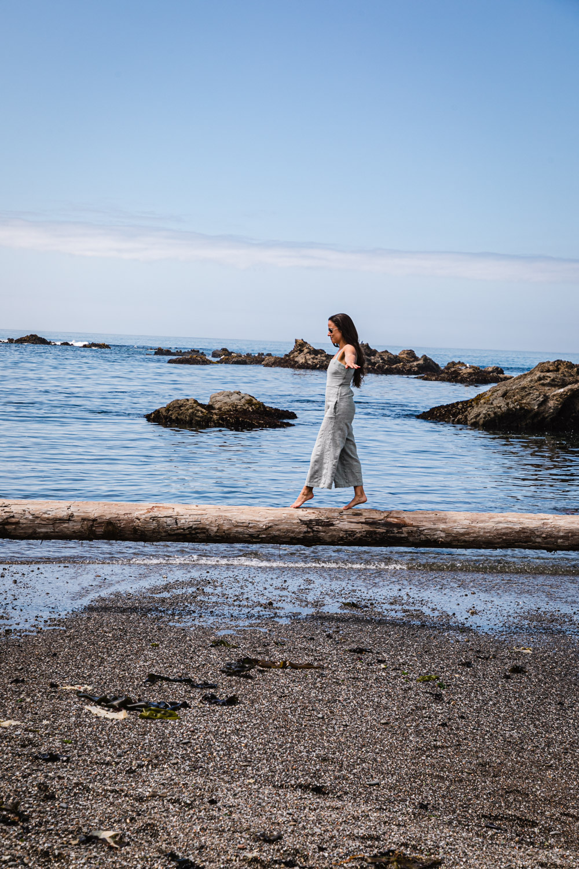 Daniela Gerson balancing on log at Glass Beach.