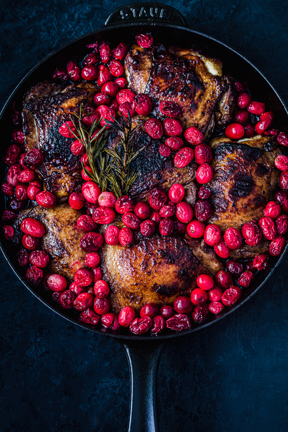 cranberry chicken in a skillet, post oven and overhead shot