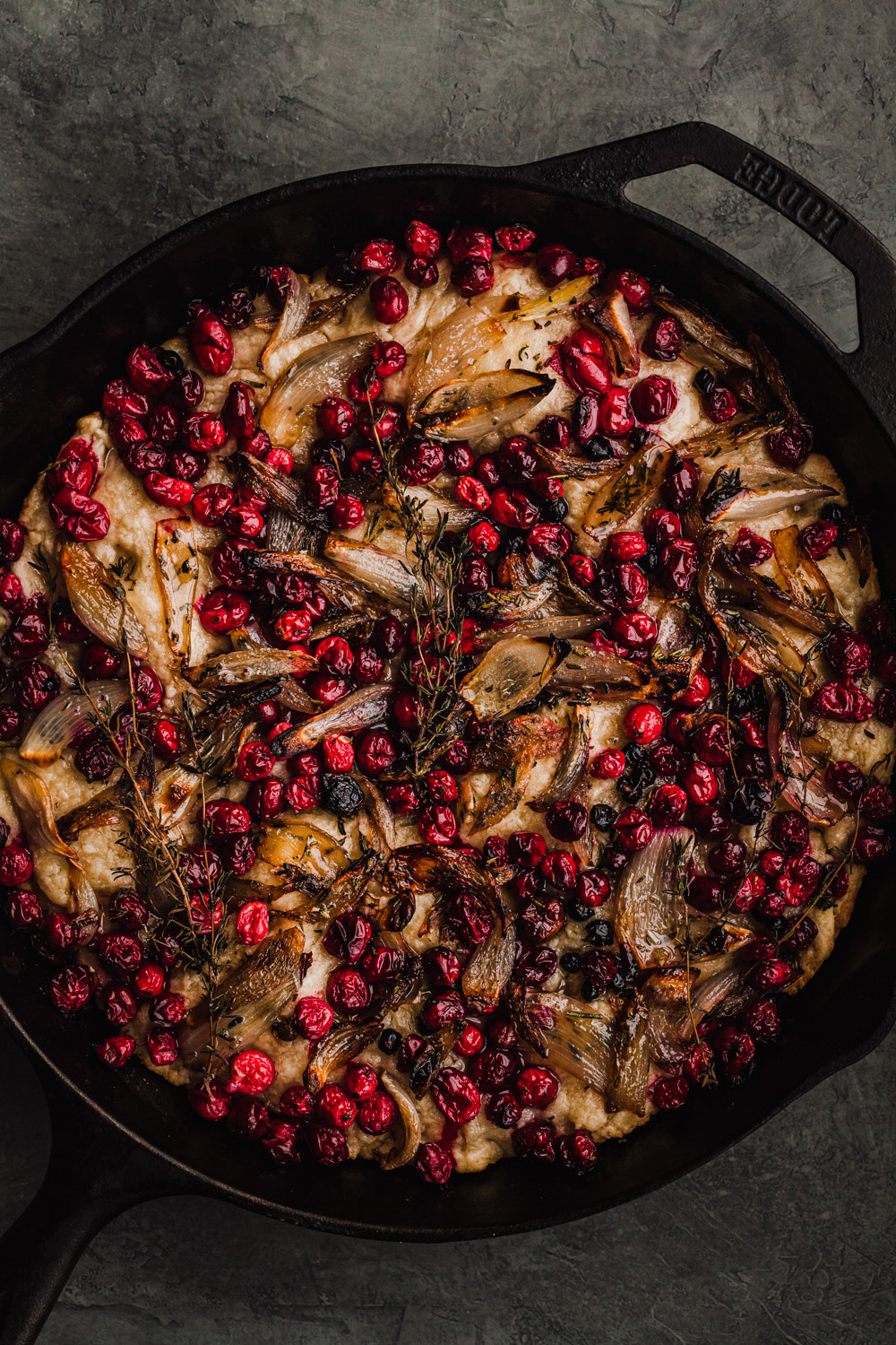 another cranberry focaccia with shallots in a skillet. just out of the oven.