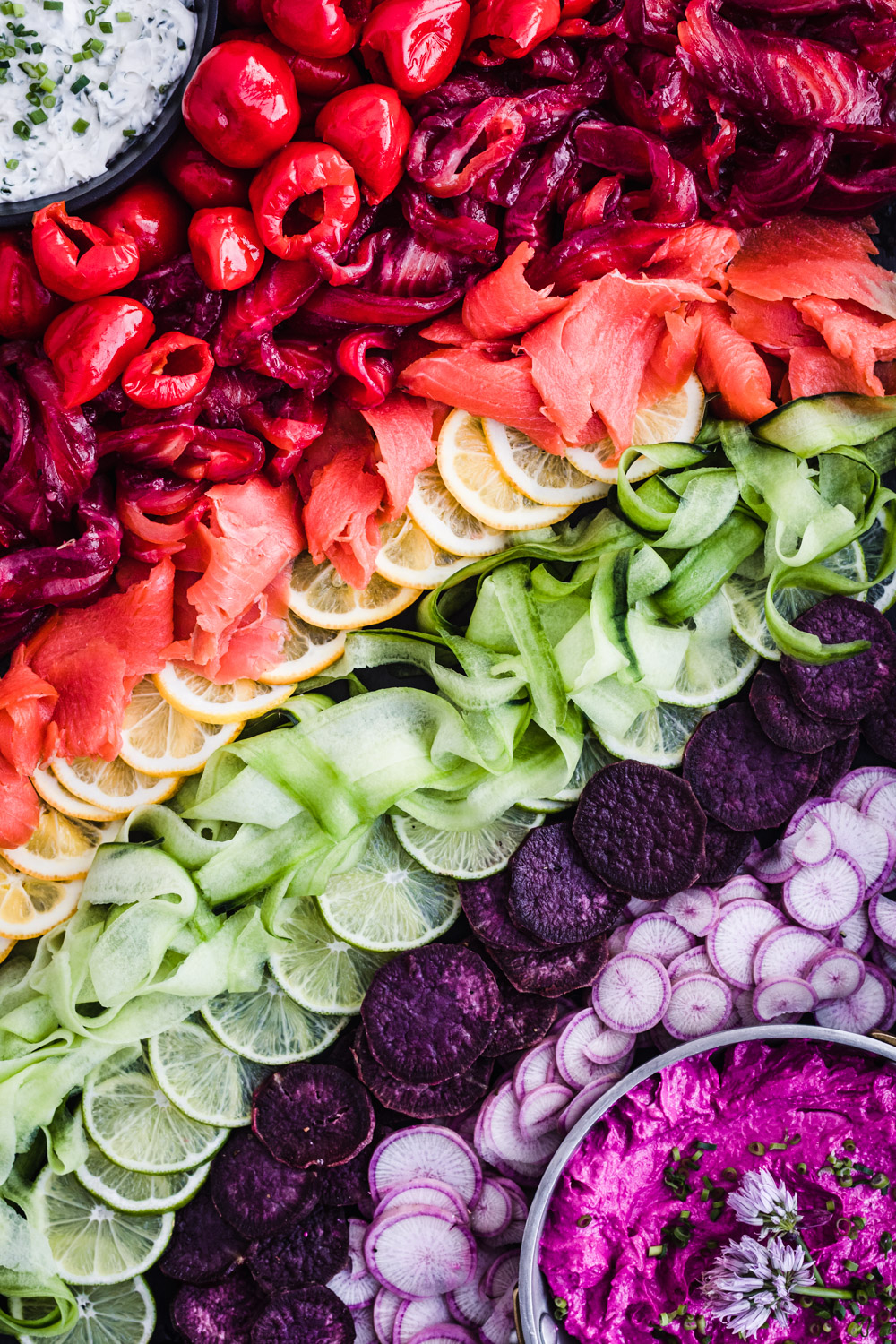 rainbow veggie and salmon platter with roasted beet and goat cheese dip
