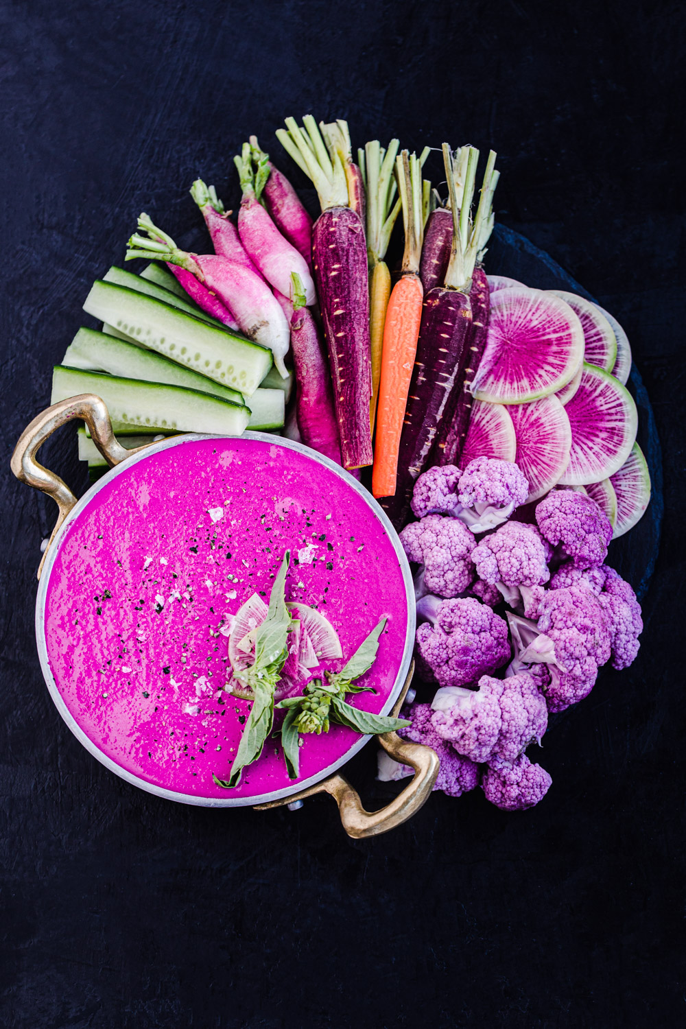 roasted beet and goat cheese dip with cucumbers, radishes, carrots and cauliflower.