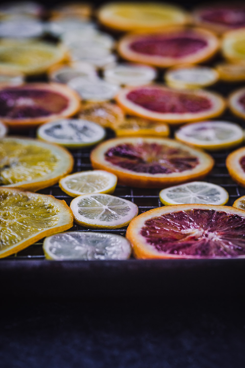 An assortment of citrus drying on a rack.