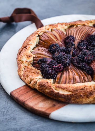 pear and blackberry galette with vanilla cream cheese, side angle shot.