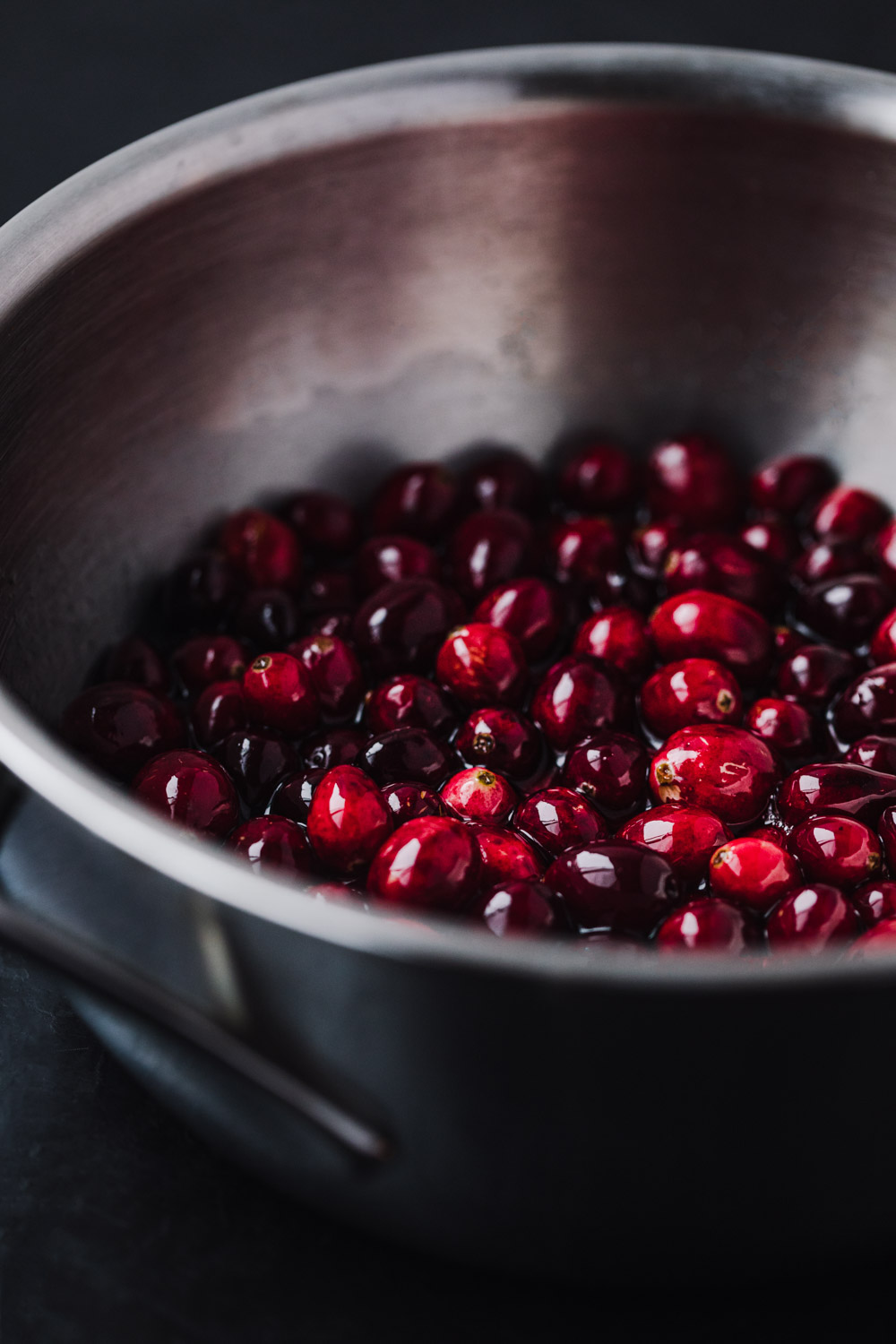 side angle shot of cranberries in simple syrup