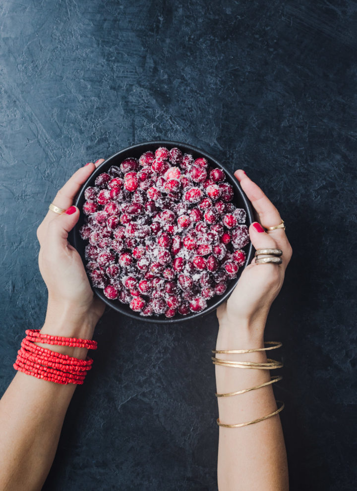 Chef Daniela Gerson holding a bowl filled with sugared cranberries.