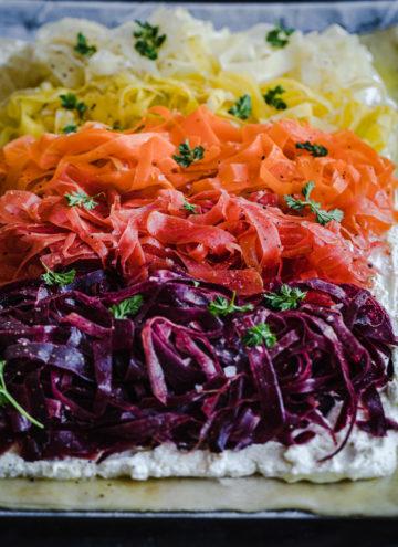 side angle shot of shaved carrot ricotta tart, pre-oven