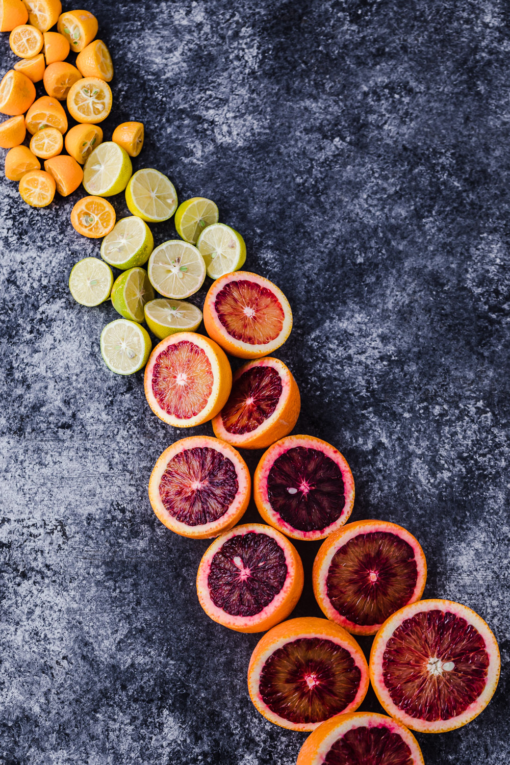 Kumquats, limequats, and blood oranges but in half