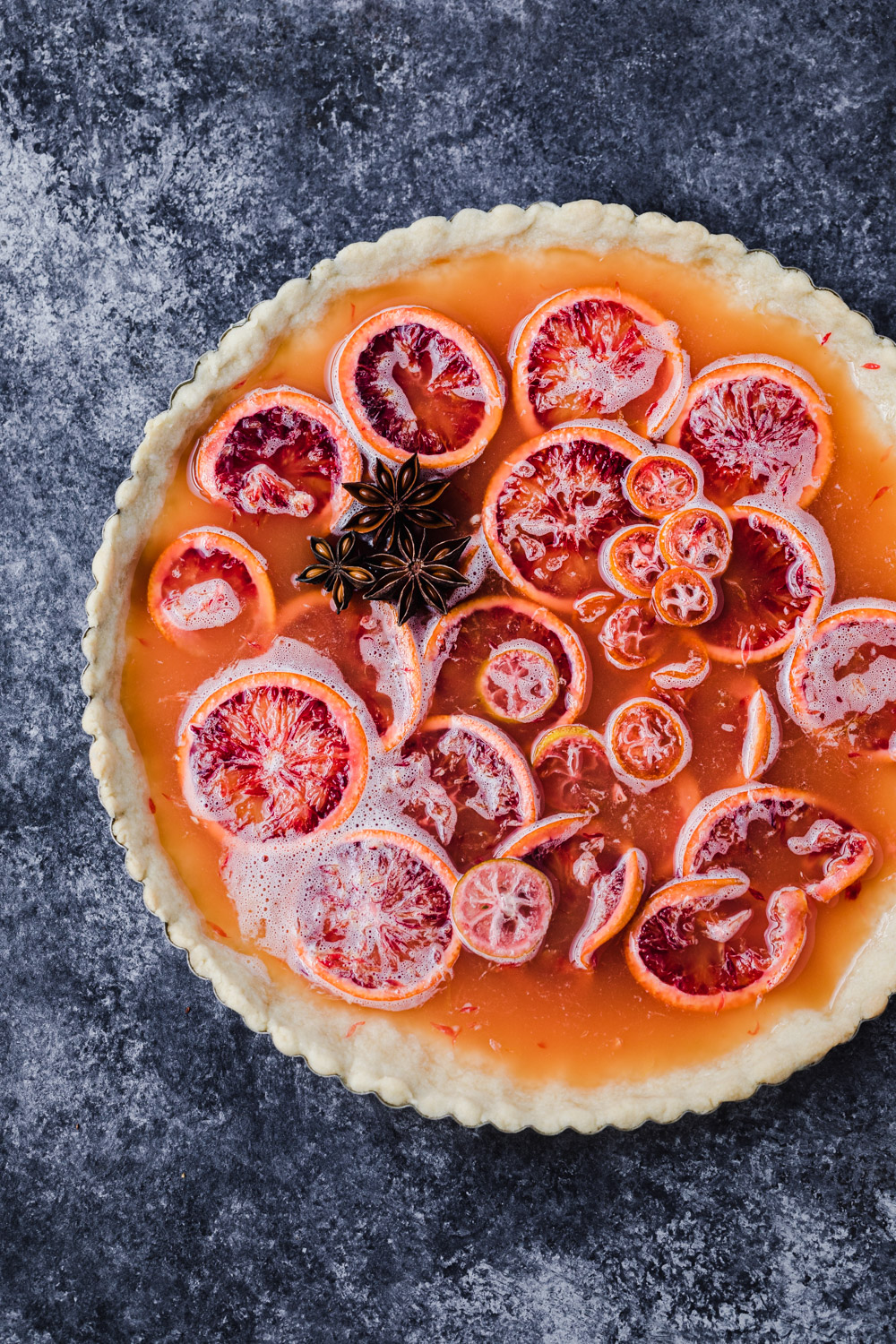 blood orange shaker tart with the addition of star anise, pre-oven