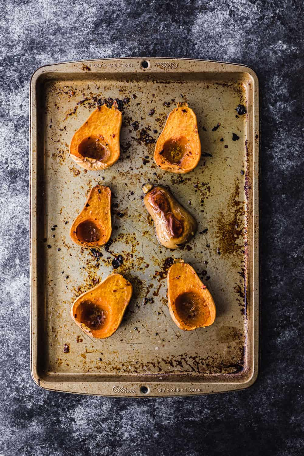 overhead shot of roasted butternut squash on a baking sheet to be used in the farmers market salad