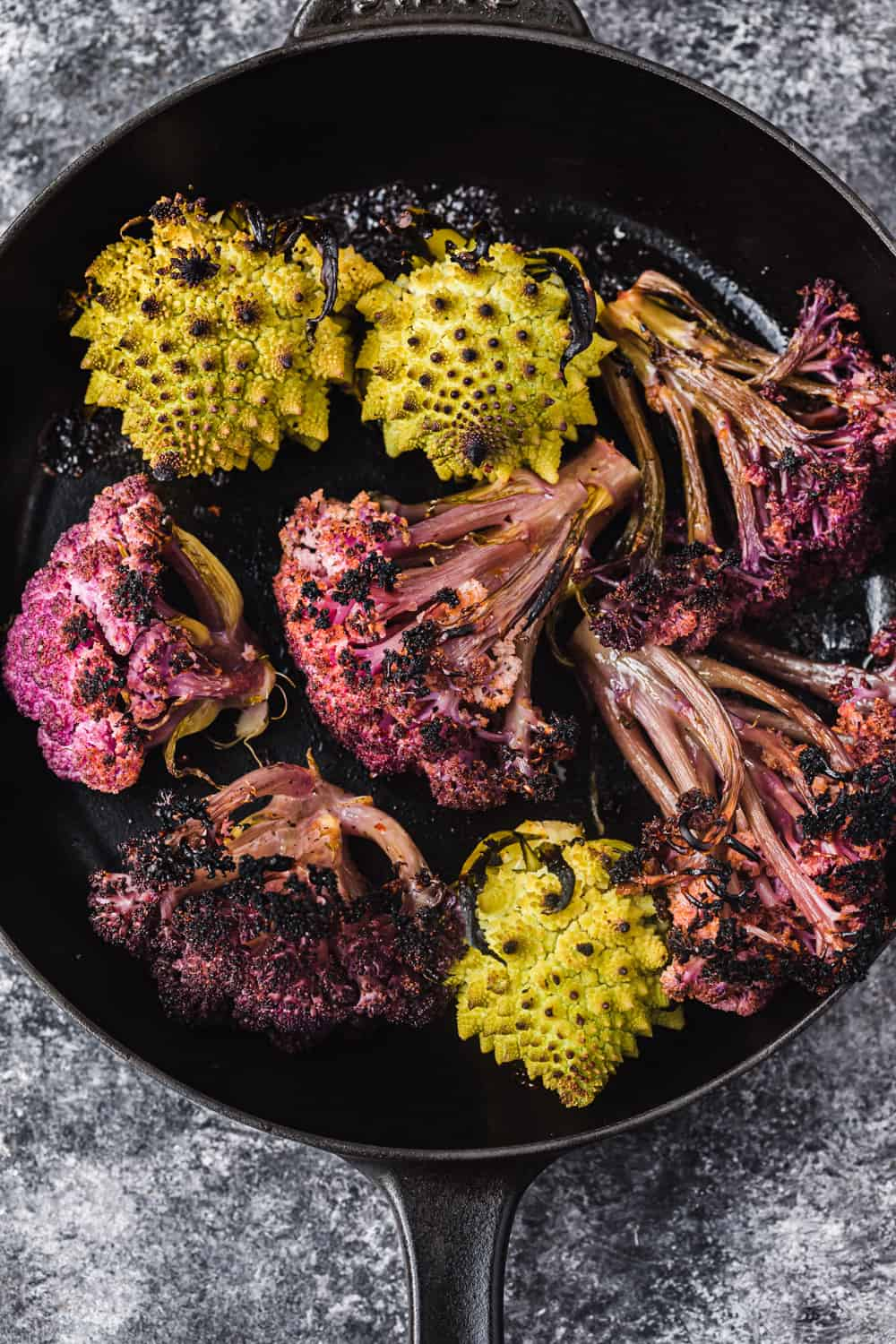 charred purple cauliflower and romanesco, just out of the oven to be used in the farmers market salad to be used in the farmers market salad